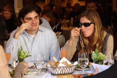 Model Gisele Bundchen eats with companion Helly Nahmad at Nello's April 12, 2003.