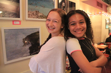 Julia Wilson and Fraya Salzman, both 13, are selling framed prints of their photography at Pie by the Pound this month.