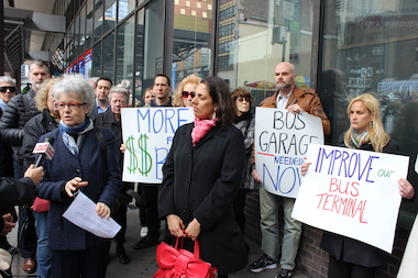 Locals called for funding for a bus garage outside the Port Authority Bus Terminal on Wednesday.
