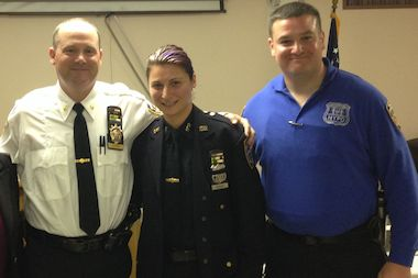 Deputy Inspector Henry Sautner, Commanding Officer of the 102nd Precinct (left) with Police Officers Diana Kaouris and Brendan Noonan