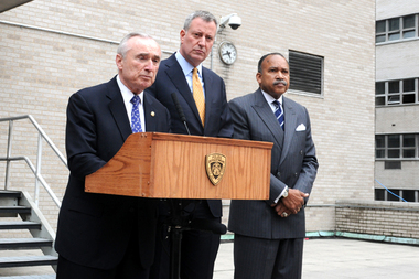 Police Commissioner Bill Bratton and Mayor Bill de Blasio said the two officers injured during a Coney Island building mattress fire remained in critical condition Tuesday during a press conference at the Police Academy in Gramercy.
