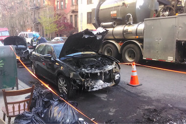 Flames poured out of manholes on West 81st Street and scorched two parked cars there, witnesses said.