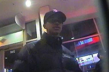 Police released a photo of a suspect taken from a Bank of America ATM located at 248 East Fordham Rd.