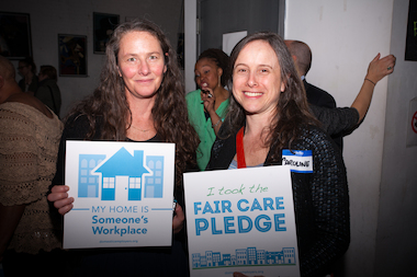 More than 120 people attended the launch of a campagin aimed at getting people who hire nannies, house cleaners and other domestic workers to become more responsible employers. Julie Dressner and Caroline Batzdorf pose for a picture after taking the pledge on Thursday, April 10, 2014.