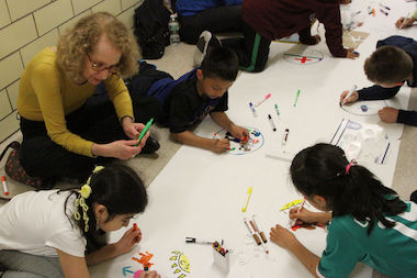 Kids from local schools have created drawings that will be transformed into fine dining pottery and auctioned off to support a literacy program run by the JCC.