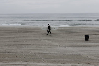 A surfer on Rockaway Beach, where five miles of beach will be closed this weekend.