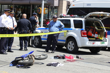 The biker was hit at Third Avenue and East 103rd Street on Tuesday afternoon, officials said.