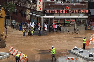 A water main break flooded East Houston Street right outside Katz's Deli Thursday morning.