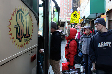 Passengers board a low-cost Chinatown bus in this photo from 2013. Community Board 3 considered three proposed Chinatown bus stops at a May 8, 2014 meeting.
