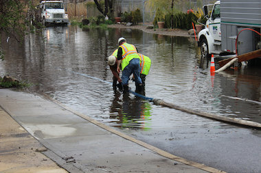 DEP employees pumping out water on a residential street in Lindenwood on May 1.