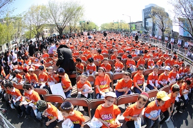 "Children wait for the Lag B'Omer parade on Eastern Parkway at the 2013 ""Great Parade."""