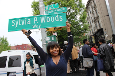 "The plan to name 126th Street at Lenox Avenue after the late soul food restaurateur Sylvia Woods had been in the works years before she passed away in 2012. But in many ways, Woods, known as the ""Queen of Soul Food,"" had long-ago placed her stamp on Harlem. ""Famous people become well known. Great people make things bigger than their own name and personality,"" activist and talk show host the Rev. Al Sharpton said Wednesday morning at ceremony renaming the street ""Sylvia P. Woods Way."""