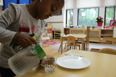Students at Twin Parks Montessori School in the Upper West Side eat on glass plates.