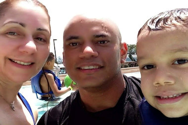 Franklin Jimenez poses with his wife Rosa and their son Joram during a family vacation.