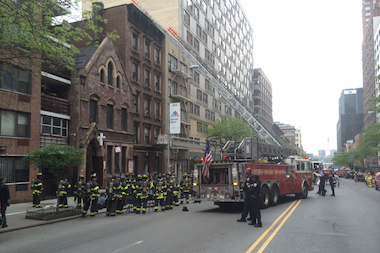 Flames engulfed the basement at the Trinity Presbyterian Church on West 57th Street, FDNY says.