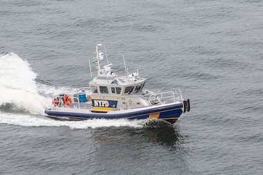 The NYPD's Harbor Patrol helped tow a dead whale to New Jersey Monday May 4, 2014, officials said.