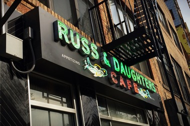 A neon sign for Russ & Daughters Cafe on Allen Street, which is opening to the public on May 7, 2014. The restaurant's entrance is located at 127 Orchard St.