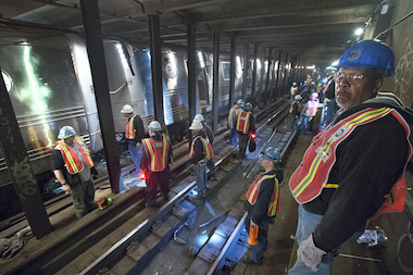 The MTA repairs the F train line on Queens Boulevard after a derailment on May 2, 2014. Another cracked rail was found near 36th Street on May 6, 2014.