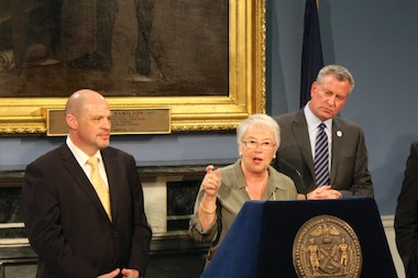 Mayor Bill de Blasio, UFT president Michael Mulgrew, and schools chancellor Carmen Farińa announce the $5.5 billion contract agreement with the city's teacher union on May 1, 2014.