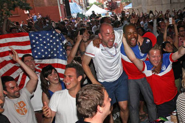 Fans cheer on the US Men's National Team during the 2014 FIFA World Cup at a viewing party under the Manhattan Bridge.