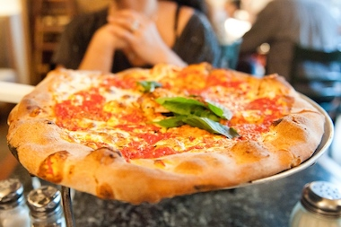 The famous Manhattan pizza chain  Patsy's Pizzeria  is bringing its slices to Brooklyn, moving within blocks of the  Barclays Center    by the end of this year, its owners said.