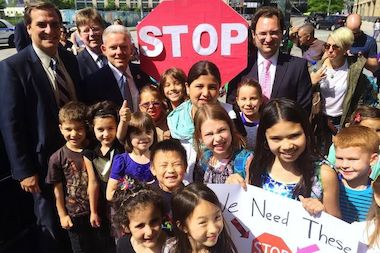 "Local officials and children from nearby P.S./I.S. 78 installed a ""People's Stop Sign"" on Center Boulevard on Friday. The group is asking for more traffic safety measures on Center Boulevard."