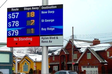 A solar-powered bus stop countdown clock on Staten Island, which was installed as part of a DOT pilot program last year.