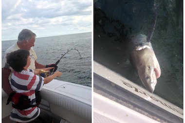 Kai, 12, reeled the great white shark in with help from his grandfather, Bob.
