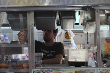 Vendors and deliverymen labored through the heat Wednesday as temperatures reached the 90s.