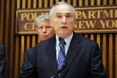 Police Commissioner William Bratton (foreground) and Manhattan District Attorney Cyrus Vance Jr. (background) say the 103 suspected gang members indicted were members of three rival crews responsible for two murders, 19 non-fatal shootings and 50 shooting incidents.