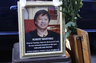 A memorial was put up for Robert Martires in Woodside after he was attacked on Roosevelt Avenue and 69th Street and Roosevelt Avenue on June 21, 2014.