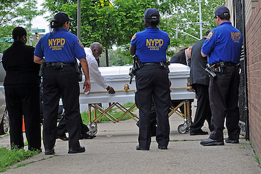 Police supervise the casket of Tanaya Copeland being brought into the funeral home for her wake on June 11, 2104.