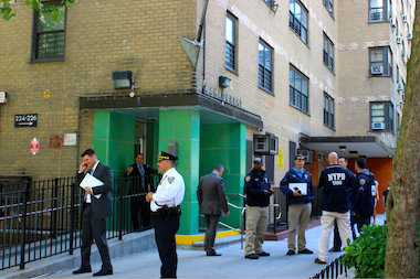 A 62-year-old woman was shot in the back in an East 28th Street apartment, police said.