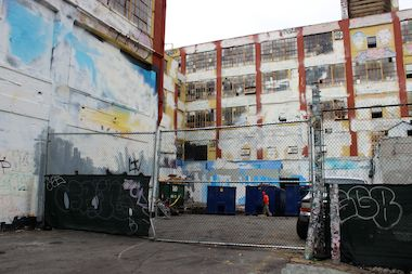 The owner of the former 5Pointz site, shown here from Davis Street, says he's looking to start demolition of the property as early as next month.