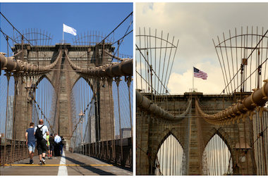 Department of Transportation workers replaced white flags that mysteriously appeared atop both towers of the Brooklyn Bridge Tuesday morning.