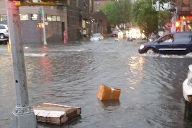 Heavy rain soaked Carroll Street and Fourth Avenue in Brooklyn Wednesday.