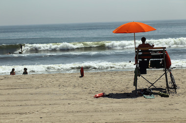 The NYPD said the lifeguards were parked in a car during the July 4 rain storm.