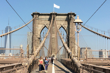 Two white flags appeared atop the Brooklyn Bridge July 22, 2014.