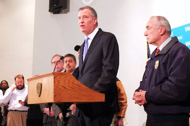"Mayor Bill de Blasio and NYPD Commissioner Bill Bratton called the shooting an ""assassination."""