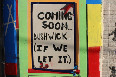 A painting at the corner of Brook Avenue and East 140th Street tells Bronxites that their neighborhood will quickly turn into Bushwick if they don't act.