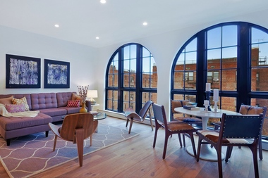 This 3-bedroom/2-bath duplex  with deeded parking in South Brooklyn's Fort Hamilton has views of the Verrazano-Narrows Bridge and an elevator opening onto the apartment. It's listed by Corcoran for $1.4 million.