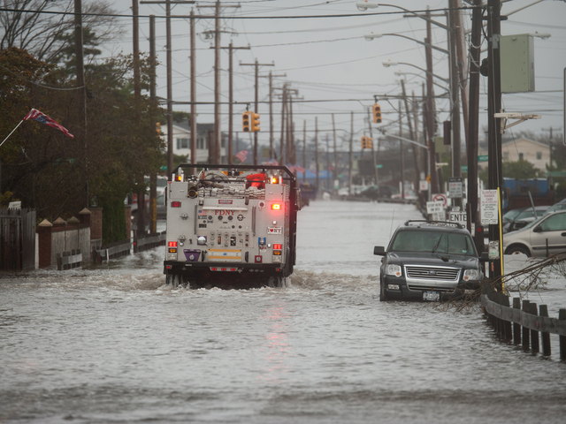 <p>Emergency vehicles navigate flood waters in Breezy Point on Tuesday October 30th, 2012.</p>