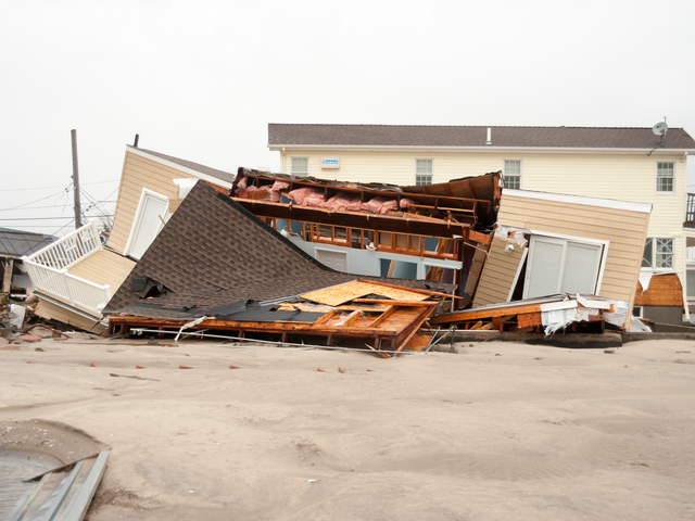 <p>The remains of a collapsed house along Stehn Promenade in The Rockaways serves as a reminder of the devastation left in the wake of Hurricane Sandy.</p>