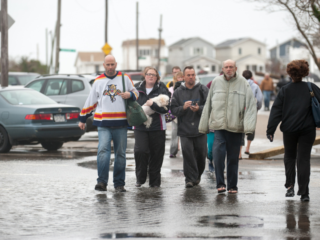 <p>Residents return to survey the damage in Breezy Point on Tuesday October 30th, 2012.</p>