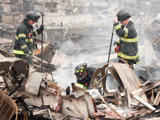 <p>Fire fighters working in Breezy Point on Oct. 30, 2012.</p>