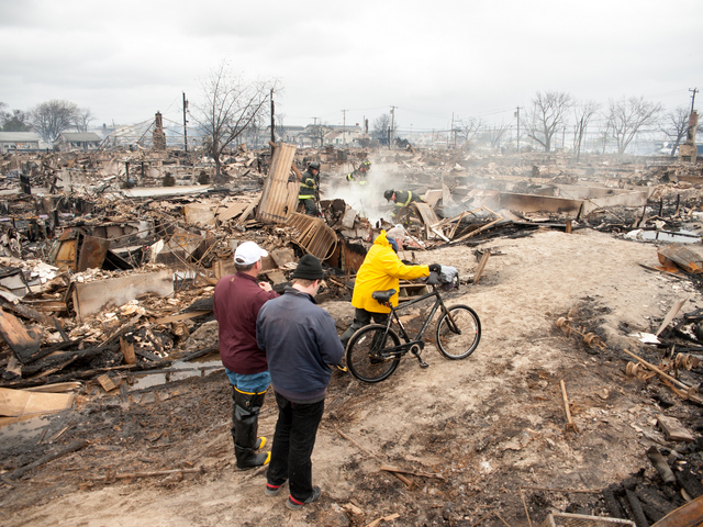 <p>Residents take stock of the destruction on Tuesday Oct. 30, 2012.</p>