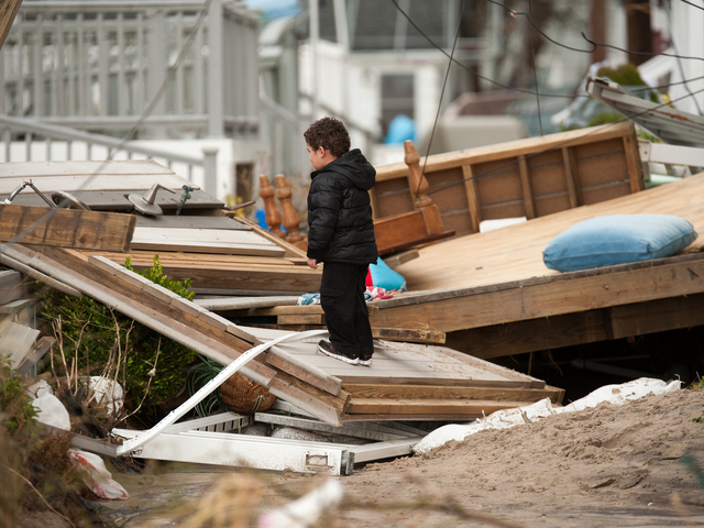 <p>Three year old Fredy Reyes stands on the remains of what used to be his familys&#39; home on Wednesday October 31st, 2012.</p>
