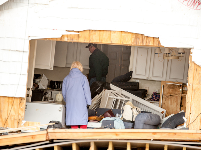 <p>Rockaway Residents save what they can of their belongings after their houses were destroyed by Hurricane Sandy.</p>
