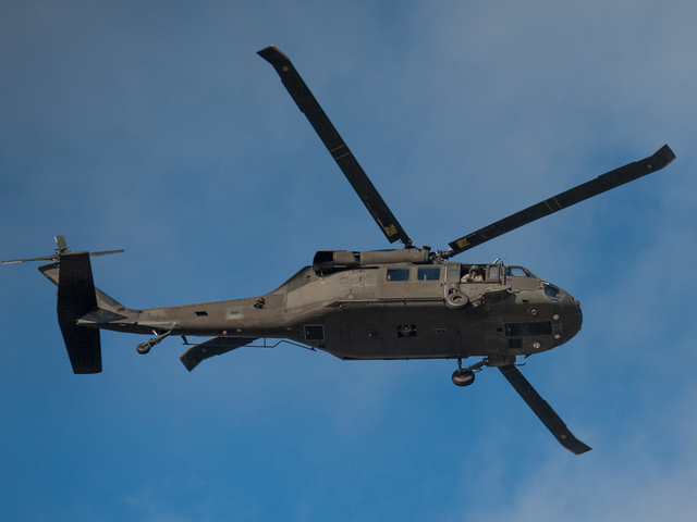 <p>A military helicopter surveys the devastation in Breezy Point on Wednesday.</p>