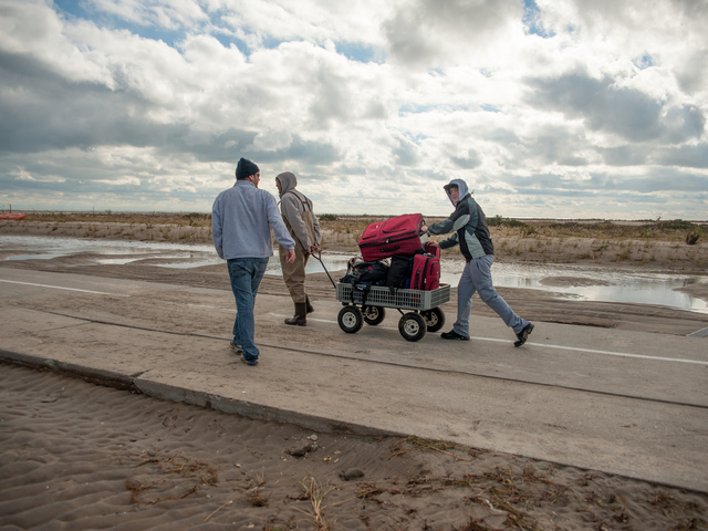 <p>Residents leave with salvaged possessions in The Rockaways.</p>